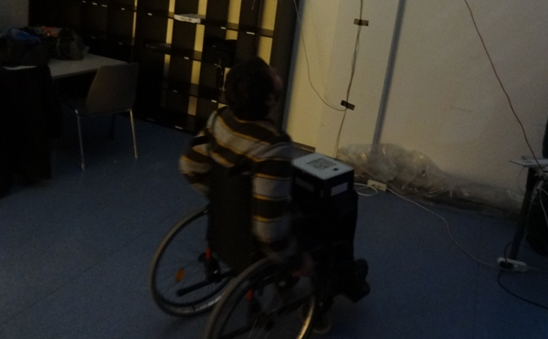 A player on the wheelchair with the infrared tracking device on his lap
